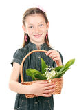 Portrait of beautiful little girl with lilies Royalty Free Stock Photos