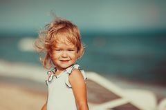 Portrait of a beautiful little girl looking at camera. Close-up. Portrait of a beautiful little girl looking at camera emotionally , wind blowing and moving her stock image
