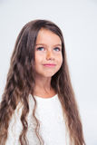 Portrait of a beautiful little girl looking up. At copyspace isolated on a white background Stock Photo