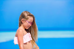 Portrait of beautiful little girl outdoor on beach Royalty Free Stock Photos