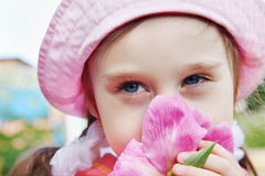 Portrait of a Beautiful Little Girl with Peony Flower Royalty Free Stock Photography