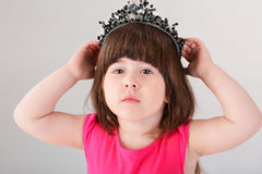 Portrait of beautiful little girl in pink Princess dress with cr Royalty Free Stock Photo