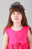 Portrait of beautiful little girl in pink Princess dress with cr Stock Images