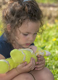 Portrait of a beautiful little girl. Little girl playing with her doll Stock Image