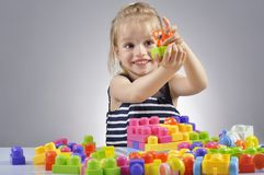 Portrait of beautiful little girl playing with plastic toy cubes Royalty Free Stock Photo