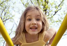 Portrait of a beautiful little girl in the playground Stock Image