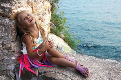 Portrait of a beautiful little girl by the sea Royalty Free Stock Photo