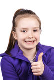Portrait of a beautiful little girl showing ok sig Royalty Free Stock Image