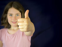 Portrait of beautiful little girl showing ok sign Royalty Free Stock Photo