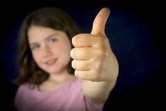 Portrait of beautiful little girl showing ok sign Royalty Free Stock Photos