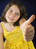 Portrait of beautiful little girl showing ok sign Stock Image