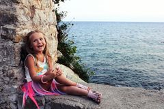 Portrait of a beautiful little girl with smile. By the sea Royalty Free Stock Image