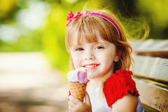 Portrait of beautiful little girl in summer green park Royalty Free Stock Photography