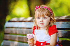 Portrait of beautiful little girl in summer green park Stock Image