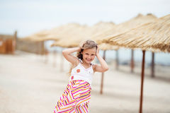Portrait of a beautiful little girl in a sundress standing on a Stock Image