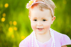 Portrait of beautiful little girl at sunny meadow background Royalty Free Stock Images