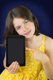 Portrait of beautiful little girl with tablet Stock Photos