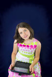 Portrait of beautiful little girl with tablet Royalty Free Stock Image