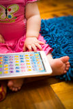 Portrait of beautiful little girl with tablet Royalty Free Stock Photo