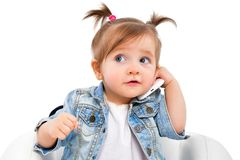 Portrait of a beautiful little girl, talking on the phone stock photos