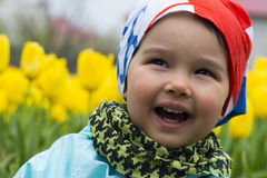 Portrait of a beautiful little girl with tulips in background Royalty Free Stock Photos