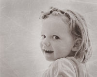 Portrait of beautiful little girl in vintage style. The image is Royalty Free Stock Photography