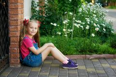 Portrait of a beautiful little girl on a walk on a summer day stock photo