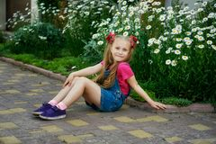 Portrait of a beautiful little girl on a walk on a summer day stock photos