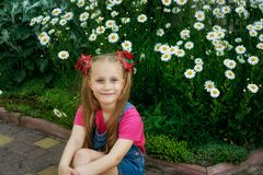 Portrait of a beautiful little girl on a walk on a summer day royalty free stock photography