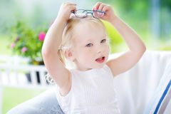 Portrait of beautiful little girl wearing glasses at home Royalty Free Stock Photo