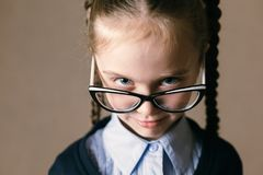 Little girl wearing glasses royalty free stock photography