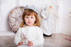 Portrait of a beautiful little girl in a white dress and a crown Royalty Free Stock Photo