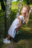 Portrait of beautiful little girl in white dress hugged stock photos