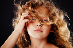 Portrait of beautiful little girl with windy hair. Fashion photo Stock Photography