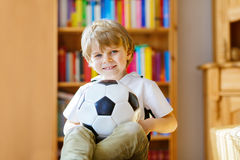 Portrait of beautiful little preschool kid boy with football. Royalty Free Stock Images