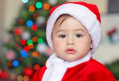 Beautiful little Santa Claus stock photo