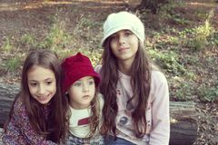 Portrait of beautiful little sisters with hats Royalty Free Stock Photography