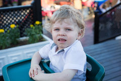 Portrait of beautiful little toddler boy sitting in outdoor rest Stock Image