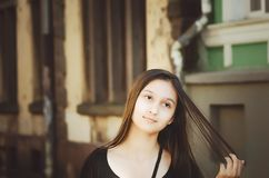 Portrait of a beautiful long-haired girl outdoors royalty free stock photography