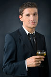 Portrait of a beautiful man. Portrait of a beautiful man with a glass of champagne Royalty Free Stock Image