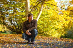 Portrait of beautiful man in autumn forest. Stock Photography