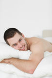 Portrait of a beautiful man lying on his belly Royalty Free Stock Photos