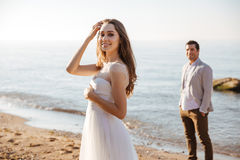 Portrait of a beautiful married couple at the beach. Portrait of a beautiful married couple standing at the beach Royalty Free Stock Images