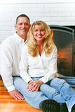 Portrait - Beautiful Married Couple. Portrait of a beautiful married couple at home in front of their fireplace Royalty Free Stock Photography