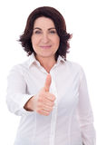 Portrait of beautiful mature business woman thumbs up isolated o Royalty Free Stock Images