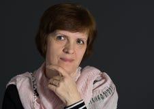 Portrait of beautiful mature Caucasian woman wearing shawl Stock Images