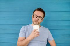 Portrait of a beautiful Mature man drinking a drink outdoors in summer royalty free stock photos