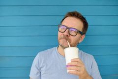 Portrait of a beautiful Mature man drinking a drink outdoors in summer stock image