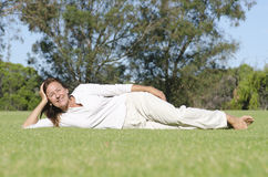 Portrait beautiful mature relaxed in park Royalty Free Stock Photography