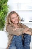 Portrait of a beautiful mature woman. Beautiful mature woman sitting on a sofa Stock Photography